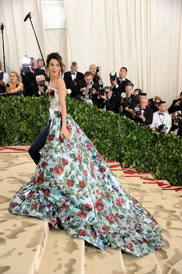 <p>For the 2018 Met Gala, Amal Clooney opted for a bespoke Richard Quinn gown in keeping with the theme of 'Heavenly Bodies: Fashion & The Catholic Imagination'. <em>[Photo: Getty]</em> </p>