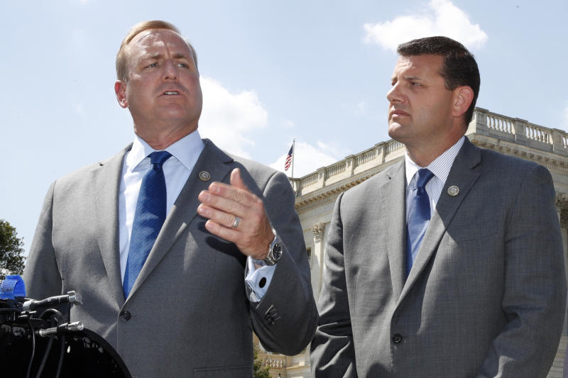 FILE - In this Wednesday, May 9, 2018 file photo, Rep. Jeff Denham, R-Calif., left, speaks next to Rep. David Valadao, R-Calif., during a news conference on Capitol Hill in Washington. The Republican incumbents were swept out of office in 2018 after a tally of late-arriving ballots. (AP Photo/Jacquelyn Martin)