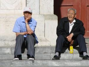 Two old men sitting on the steps