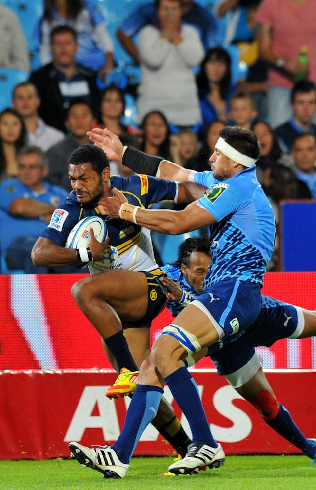Australian ACT Brumbies' winger Henry Speight (L) runs to score a try during the Super 15 Rugby Match between Northern Bulls and Canterbury Crusaders at Loftus Versfeld stadium in Pretoria, on April 21, 2012. AFP PHOTO/ ALEXANDER JOE (Photo credit should read ALEXANDER JOE/AFP/Getty Images)