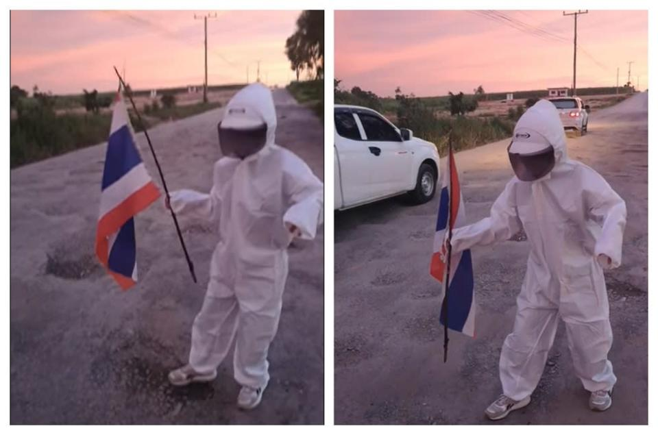 Wansueb wearing her astronaut outfit while walking on the road filled with potholes. ― Picture via Facebook/AomamChaluayjit Wansueb