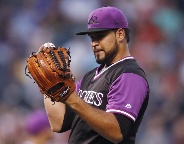 Colorado Rockies starting pitcher Antonio Senzatela reacts after giving up a two-run home run to St. Louis Cardinals' Miles Mikolas in the second inning of a baseball game Friday, Aug. 24, 2018, in Denver. (AP Photo/David Zalubowski)