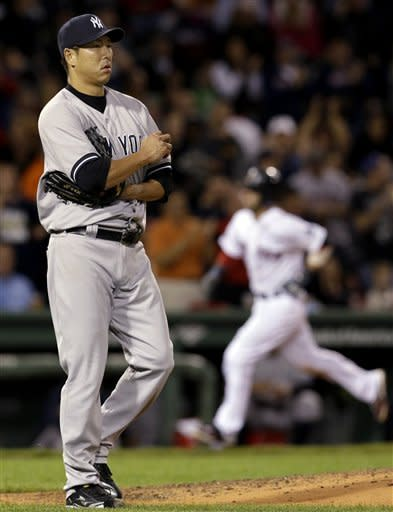 New York Yankees starting pitcher Hiroki Kuroda, of Japan, reacts as Boston Red Sox's Dustin Pedroia rounds third after his solo home run in the sixth inning of a baseball game at Fenway Park in Boston, Tuesday, Sept. 11, 2012. (AP Photo/Elise Amendola)