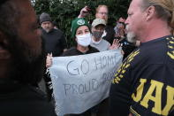 Anti-fascist counter-protesters confront Proud Boys as they rally on the outskirts of town on Sunday, Aug. 22, 2021, in Portland, Ore. (AP Photo/Alex Milan Tracy)