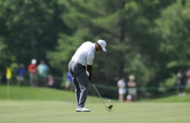 Tiger Woods hits on the fifth fairway during the Pro-Am at the Quicken Loans National golf tournament, Wednesday, June 25, 2014, in Bethesda, Md. (AP Photo/Nick Wass)
