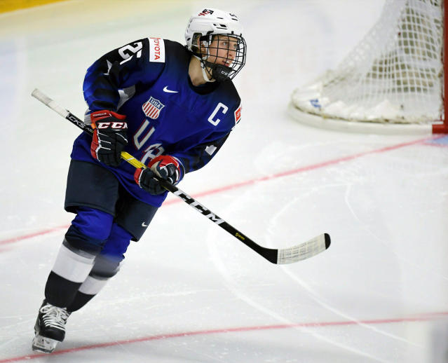 FILE - In this April 6, 2019, file photo, Kendall Coyne Schofield of Team USA looks on during the 2019 IIHF Women's World Championships preliminary match against Canada, in Espoo, Finland. More than 200 of the top female hockey players in the world have decided they will not play professionally in North America next season, hoping their stand leads to a single economically sustainable league. The announcement Thursday, May 2, 2019, comes after the Canadian Women's Hockey League abruptly shut down as of Wednesday, leaving the five-team, U.S.-based National Women's Hockey League as the only pro league in North America. The group of players, led by American stars Hilary Knight and Kendall Coyne Schofield and Canadian goaltender Shannon Szabados, hopes their move eventually pushes the NHL to start its own women's hockey league as the NBA did with the WNBA. (Antti Aimo-Koivisto/Lehtikuva via AP, File)