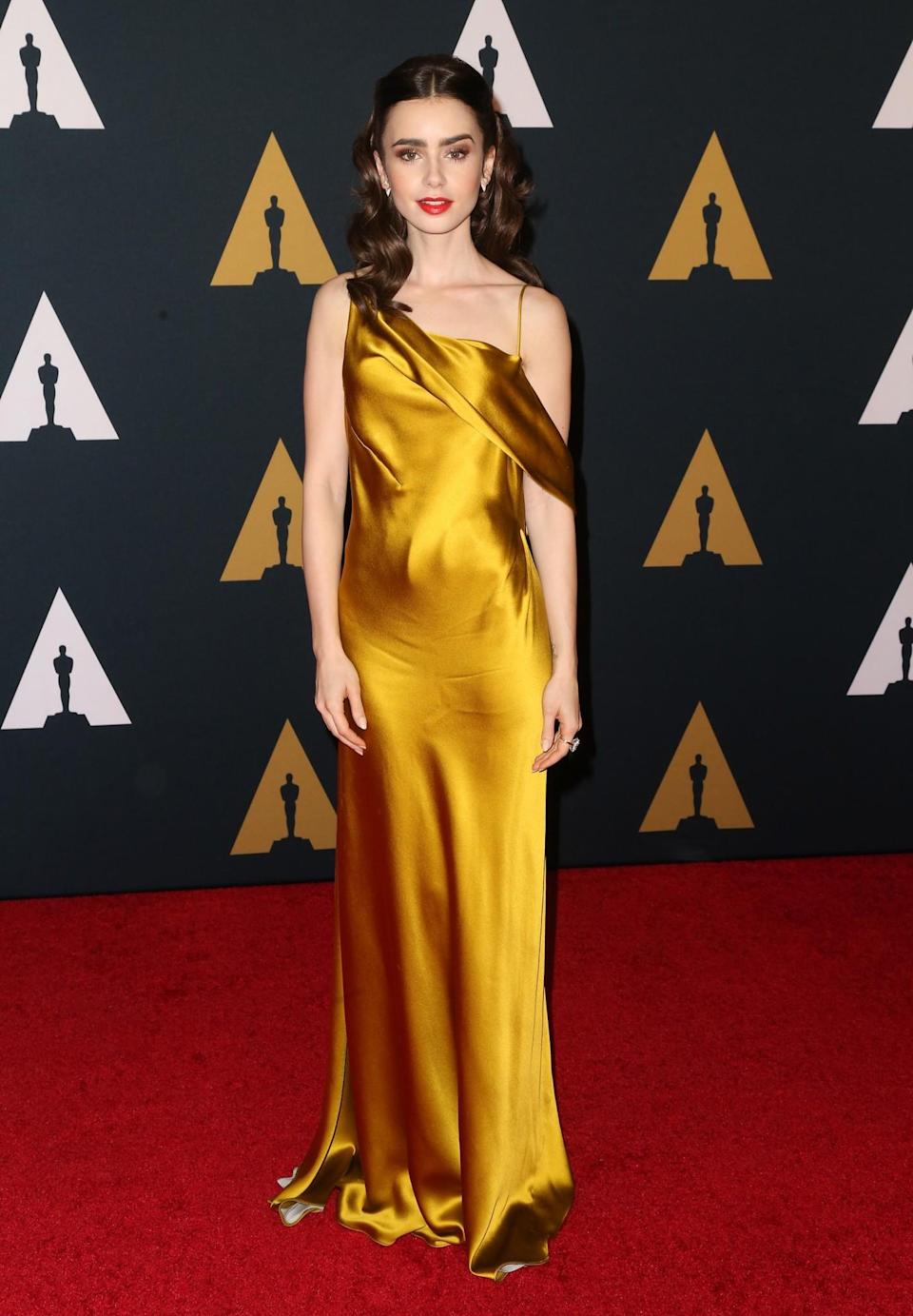 <p>Lily looked like a walking Oscar (in a good way, of course) in a sophisticated Amanda Wakeley gown. <i>[Photo: Getty]</i> </p>