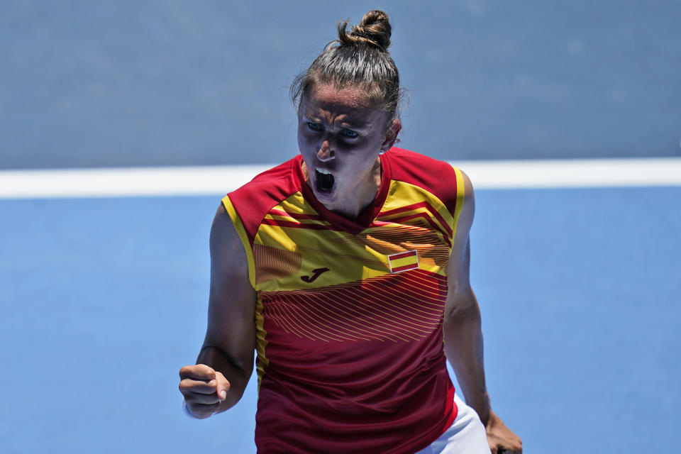Sara Sorribes Tormo, of Spain, reacts after winning the first set against Ashleigh Barty, of Australia, during the first round of the tennis competition at the 2020 Summer Olympics, Sunday, July 25, 2021, in Tokyo, Japan. (AP Photo/Seth Wenig)