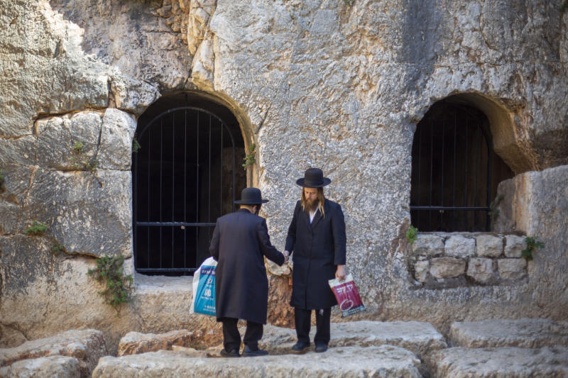 In this Thursday, Oct. 31, 2019 photo, ultra-Orthodox Jews visits the Tomb of the Kings, a large underground burial complex dating to the first century BC, in east Jerusalem neighborhood of Sheikh Jarrah. After several aborted attempts, the French Consulate General has reopened one of Jerusalem's most magnificent ancient tombs to the public for the first time in over a decade, sparking a distinctly Jerusalem conflict over access to an archaeological-cum-holy site in the volatile city's eastern half. (AP Photo/Ariel Schalit)