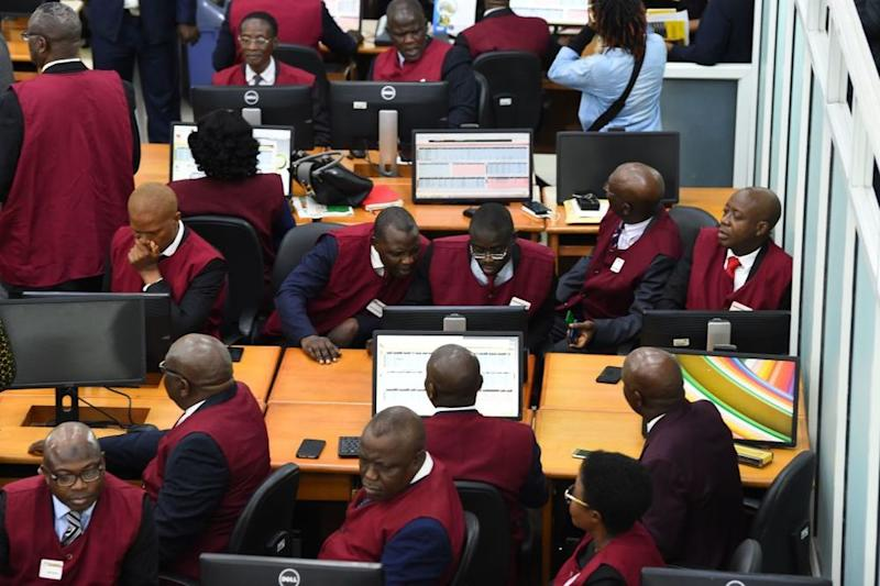 Stockbrokers work at the Nigerian Stock Exchange in Lagos in May. Africa's largest economy is one of the final hold-outs for the continent-wide trade deal. (Photo by PIUS UTOMI EKPEI / AFP)