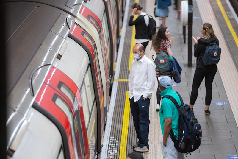Commuters at Clapham Common underground station, London, as train services increase this week as part of the easing of coronavirus lockdown restrictions.