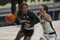 Louisville guard Dana Evans, left, drives around Wake Forest guard Gina Conti (5) in the first quarter of an NCAA women's college basketball game in Winston-Salem, N.C., Sunday, Jan. 24, 2021. (AP Photo/Nell Redmond)
