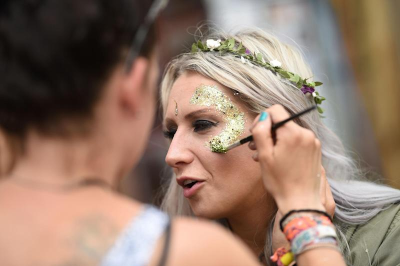 A festival-goer has her face painted with glitter at Glastonbury 2017: AFP/Getty Images