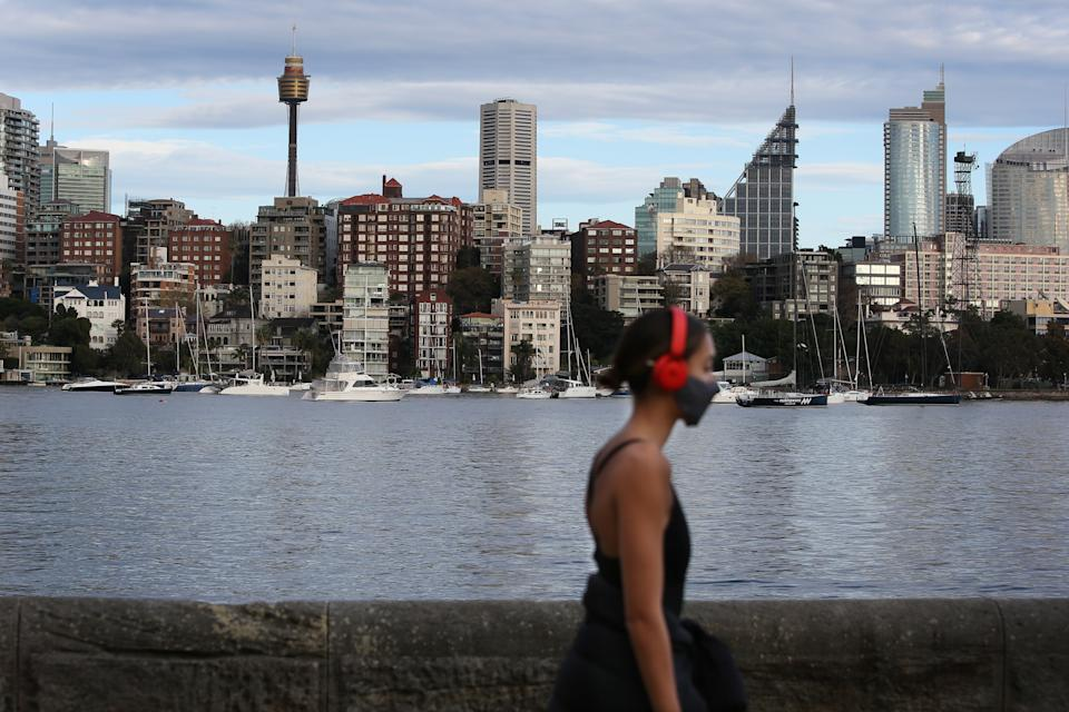 A person is seen exercising whilst wearing a face mask in the early morning at Rushcutters Bay on August 23. Source: Getty