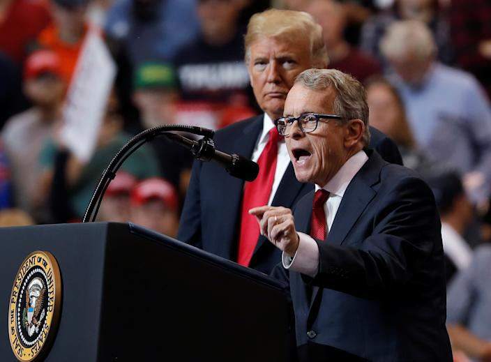 President Donald Trump listens as then Ohio gubernatorial nominee and Ohio Attorney General Mike Dewine speaks during a campaign rally in Cleveland, Ohio in 2018. (Carlos Barria/Reuters)