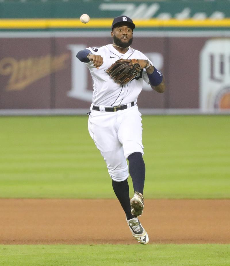 Tigers shortstop Niko Goodrum throws out Reds shortstop Freddy Galvis during the eighth inning of the Tigers' 7-2 win at Comerica Park on Friday, July 31, 2020.