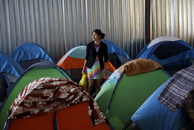 A woman from Guatemala, who did not give her name, waits at a shelter of mostly Mexican and Central American migrants to begin the process of applying for asylum Friday, April 12, 2019, in Tijuana, Mexico. The Trump administration is asking an appeals court to let it continue returning asylum seekers to Mexico hours before a U.S. judge's order was set to go into effect Friday afternoon reversing the unprecedented change to the U.S. asylum process. (AP Photo/Gregory Bull)