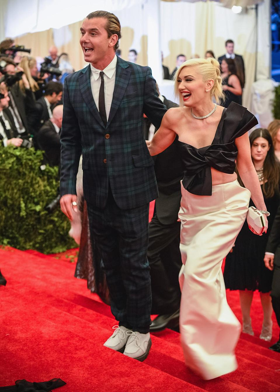 """<p>The theme for the 2013 Met Gala """"PUNK: Chaos to Couture"""" was right up Gwen's alley. While Rossdale wore a plaid suit and platform brogues, Gwen stood by his side making a statement in this Maison Martin Margiela number.</p>"""