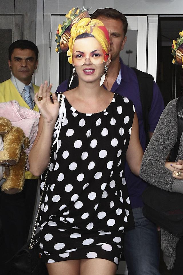 """Pop tart Katy Perry played with photographers and payed homage to Carmen Miranda by donning a mask of the samba singer upon landing in Rio de Janeiro, Brazil. Dare I say this hairstyle suits Katy more than the majority of her actual coifs? Oh, wait. I just did. Honopix/<a href=""""http://www.pacificcoastnews.com/"""" target=""""new"""">PacificCoastNews.com</a> - September 22, 2011"""