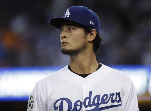 Los Angeles Dodgers starting pitcher Yu Darvish walks to the dugout during the first inning of Game 7 of the 2017 World Series. (AP)