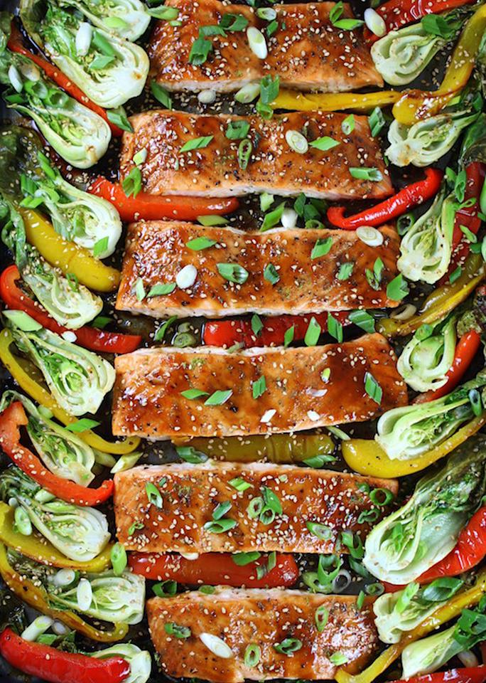 """Rich salmon can stand up to a sticky honey-lime glaze and roasts up with veggies in this fast <a rel=""""nofollow"""" href=""""http://tasteandsee.com/honey-lime-roasted-sheet-pan-salmon-and-vegetables-recipe/"""">dinner</a>."""