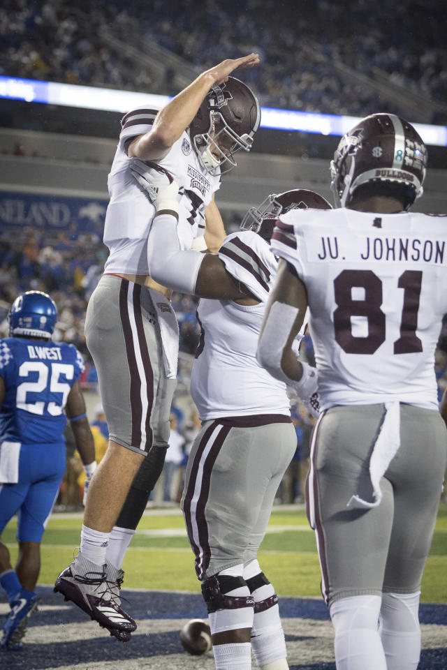 Mississippi State quarterback Nick Fitzgerald (7) celebrates with teammates after scoring a touchdown during an NCAA college football game against Kentucky in Lexington, Ky., Saturday, Sept. 22, 2018. (AP Photo/Bryan Woolston)
