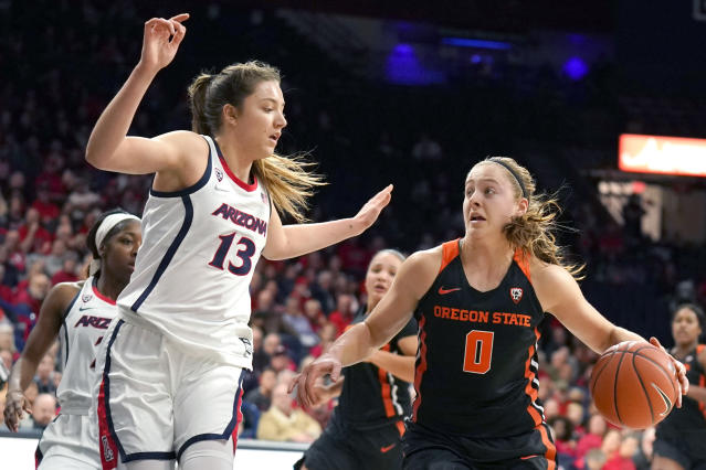 Oregon State guard Mikayla Pivec (0) drives against Arizona guard Helena Pueyo (13) during the first half of an NCAA college basketball game Friday, Jan. 10, 2020, in Tucson, Ariz. (AP Photo/Rick Scuteri)