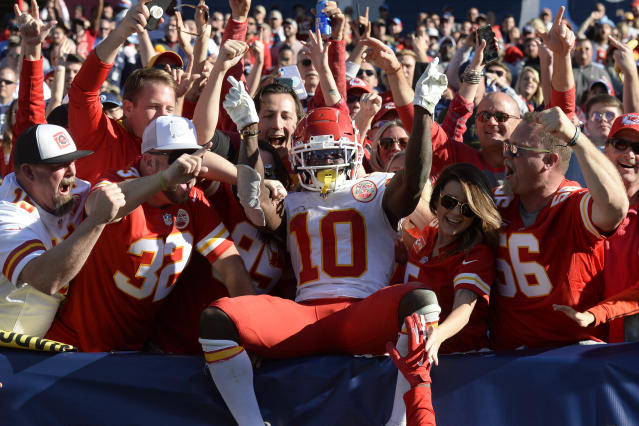 Kansas City Chiefs wide receiver Tyreek Hill (10) celebrates with fans after scoring a touchdown against the Tennessee Titans in the second half of an NFL football game Sunday, Nov. 10, 2019, in Nashville, Tenn. (AP Photo/Mark Zaleski)
