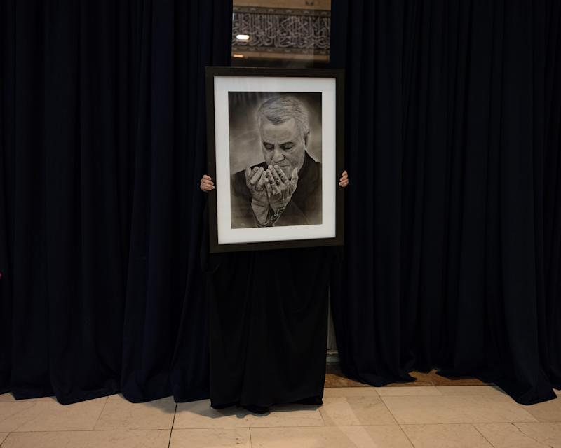 A portrait of Soleimani is held during the three official days of mourning. | Newsha Tavakolian—Magnum Photos for TIME