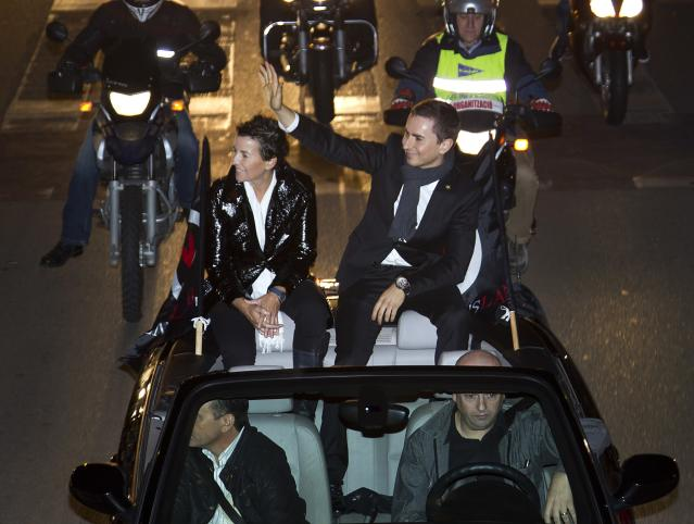 Moto GP world champion Spain's rider Jorge Lorenzo (R) waves to his fans as he sits in a car in Palma de Mallorca during a parade on November 19, 2012. AFP PHOTO/ JAIME REINAJAIME REINA/AFP/Getty Images
