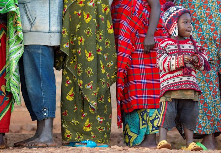This boy waits alongside adults in line to vote for Burundi's general election on Wednesday, which at least one opposition figure has already labeled a farce.