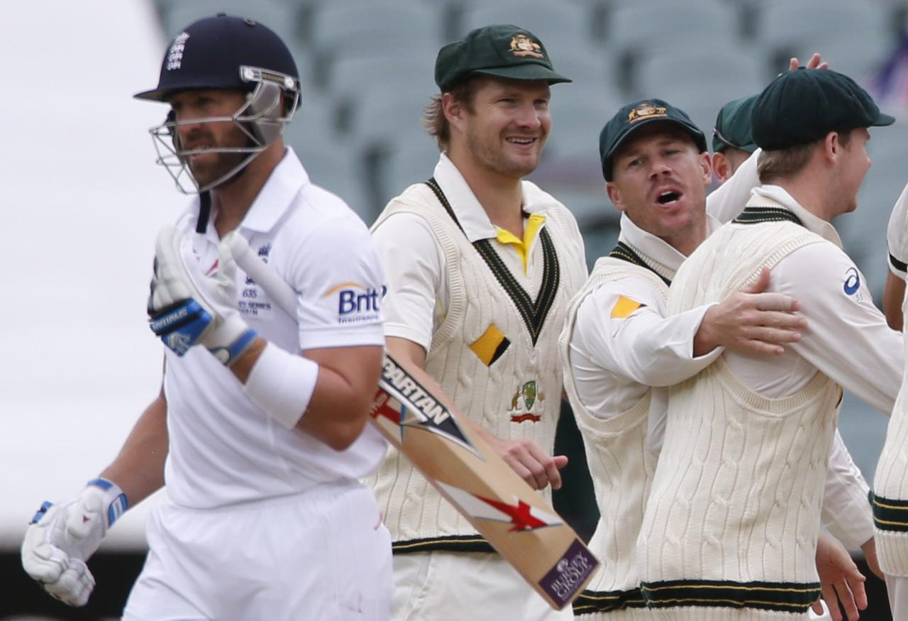 Australia's David Warner (2nd R) shouts at England's Matt Prior (L) as he and his team mates celebrate Prior's dismissal during the fifth day's play in the second Ashes cricket test at the Adelaide Oval December 9, 2013. REUTERS/David Gray (AUSTRALIA - Tags: SPORT CRICKET)