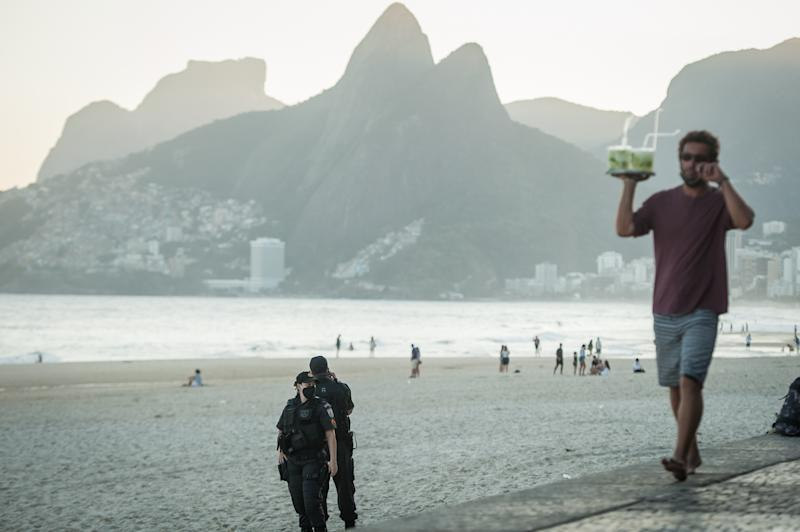 Police officers are seen inspecting the ipanema beach located in the south of the city of Rio de Janeiro, Brazil, on July 19, 2020. Local authorities start the 4th (fourth) of the 6 stages of the easing of social isolation (quarantine) or that allows some collective sports on the beach sand, except on weekends. Rio de Janeiro surpassed the mark of 11,000 deaths caused by coronavirus (COVID-19) and more than 135,000 confirmed cases by the disease. (Photo by Allan Carvalho/NurPhoto via Getty Images)