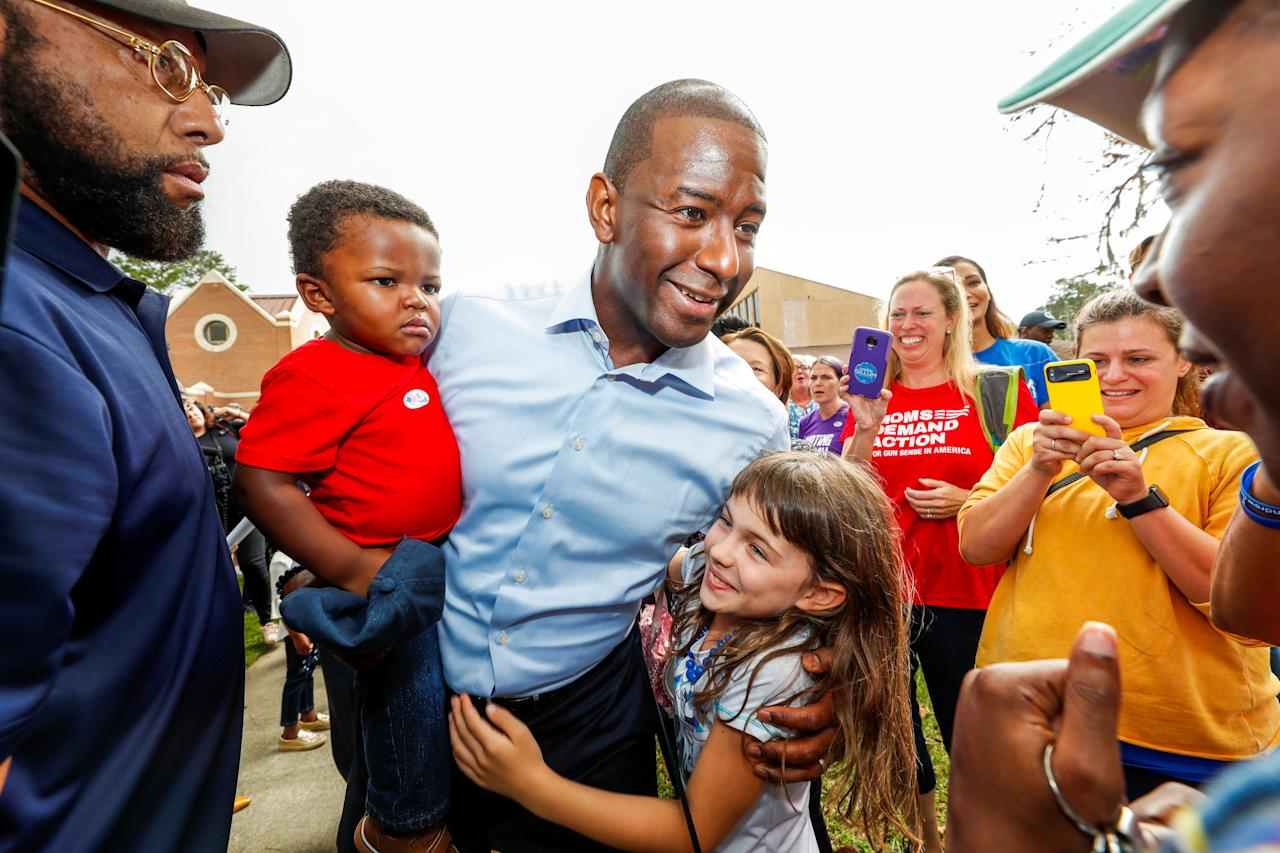 <p>Democratic gubernatorial candidate Andrew Gillum holds his son Davis, age 16 months, as he greets well-wishers outside his polling place after voting during midterm elections in Tallahassee, Fla., Nov. 6, 2018. (PhotoL Colin Hackley/Reuters) </p>
