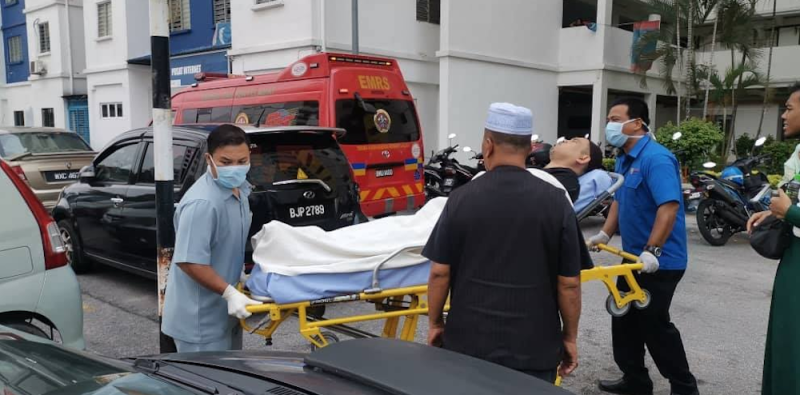 A man is stretchered from the scene. — Picture via Twitter/Bernamadotcom