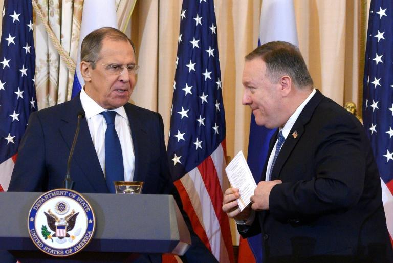 US Secretary of State Mike Pompeo (R) voiced hope for more productive ties with Russia but made clear that the two powers had plenty of disagreements and warned Foreign Minister Sergei Lavrov (L) about 2020 election integrity (AFP Photo/ANDREW CABALLERO-REYNOLDS)