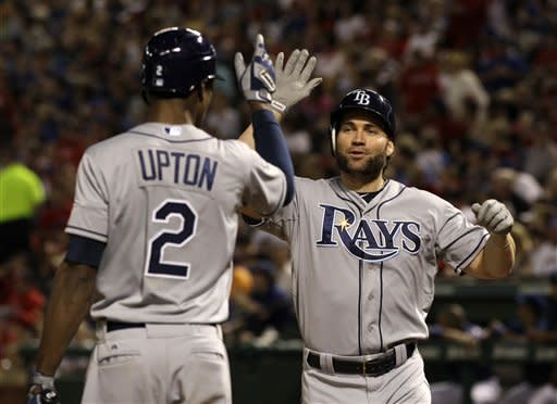 Tampa Bay Rays' B.J. Upton (2) congratulates teammate Luke Scott, right, following Scott's solo home run in a pinch-hit appearance off of Texas Rangers relief pitcher Mark Lowe in the sixth inning of a baseball game on Friday, April 27, 2012, in Arlington, Texas. (AP Photo/Tony Gutierrez)
