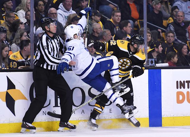 Apr 21, 2018; Boston, MA, USA; Boston Bruins right wing David Backes (42) checks Toronto Maple Leafs defenseman Jake Gardiner (51) into linesman Pierre Racicot during the first period in game five of the first round of the 2018 Stanley Cup Playoffs at TD Garden. Mandatory Credit: Bob DeChiara-USA TODAY Sports TPX IMAGES OF THE DAY