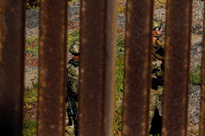 <p>Agents with the U.S. Border Patrol Tactical Unit (BORTAC) stand guard behind the border fence between Mexico and the United States, as seen from Tijuana, Mexico, Nov. 14, 2018. (Photo: Jorge Duenes/Reuters) </p>
