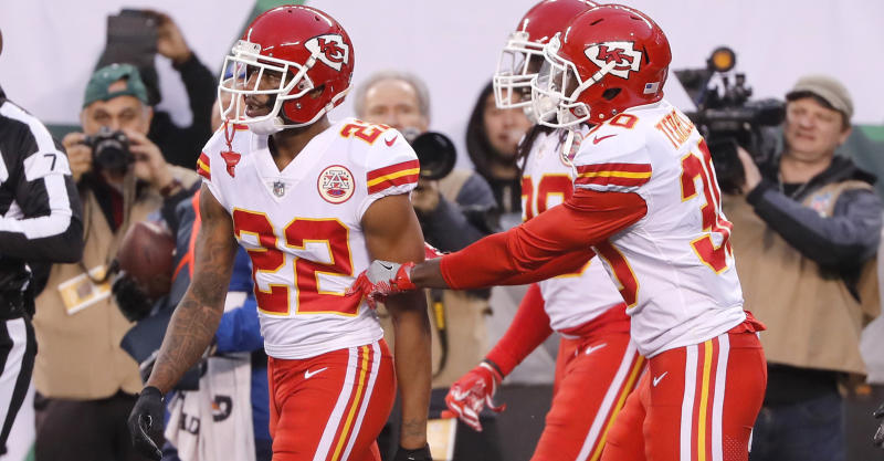 Teammates of Kansas City Chiefs' Marcus Peters, left, try to prevent him from leaving the field after a penalty during the second half of the team's game against the New York Jets on Sunday. (AP)