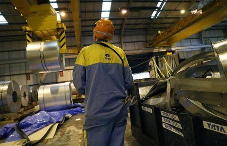 A worker cranes a coil of steel to be used on Tata Steel's new robotic welding line at their Automotive Service Centre in Wednesfield