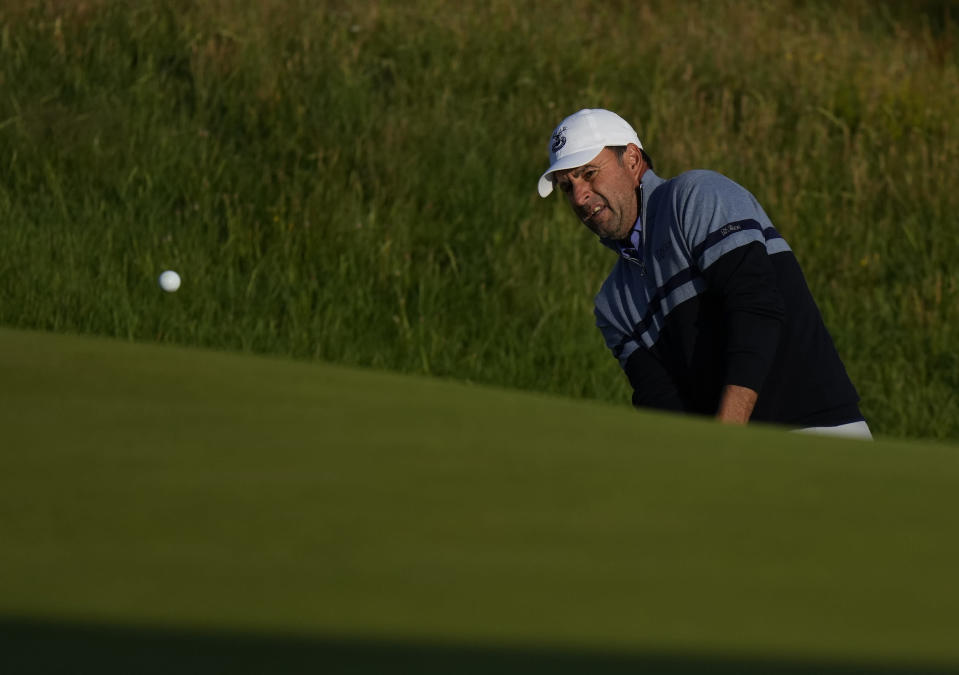 England's Richard Bland chips onto the 2nd green during the first round British Open Golf Championship at Royal St George's golf course Sandwich, England, Thursday, July 15, 2021. (AP Photo/Alastair Grant)