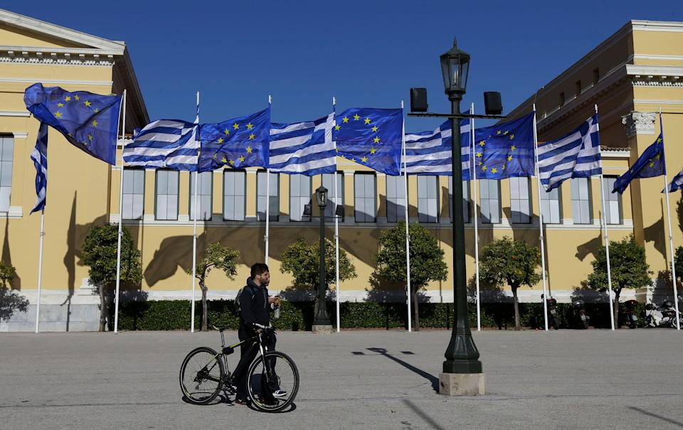 Greek and European Union's flags wave outside Zappeio Hall in Athens, on Friday, Jan. 23, 2015. (AP Photo/Thanassis Stavrakis)