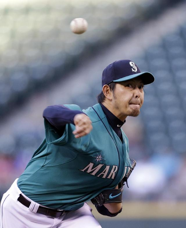 Seattle Mariners starting pitcher Hisashi Iwakuma throws against the Minnesota Twins in the fourth inning of a baseball game Monday, July 7, 2014, in Seattle. (AP Photo/Elaine Thompson)