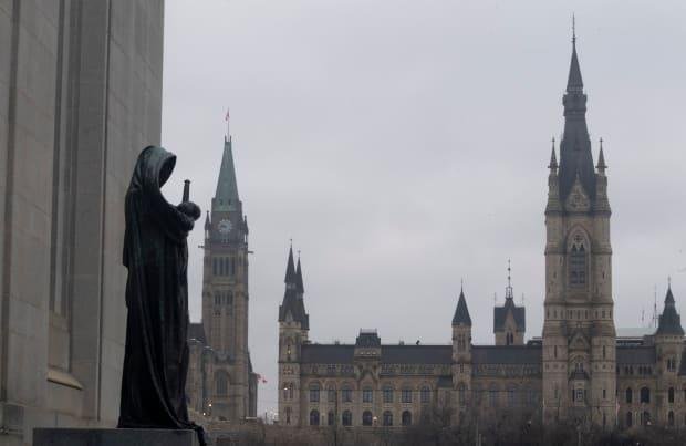 The statue representing justice looks out from the Supreme Court of Canada over the parliamentary precinct in Ottawa this week. Canada remains vigilant in its battle against COVID-19.
