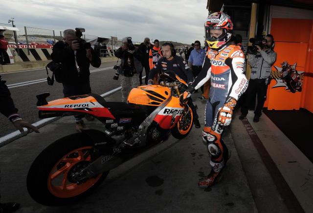 Repsol Honda Team's Australian Casey Stoner is seen in the pit during the Moto GP training session of Valencia's Grand Prix at Ricardo Tormo racetrack in Cheste, on November 04, 2011. AFP PHOTO / JOSE JORDAN (Photo credit should read JOSE JORDAN/AFP/Getty Images)