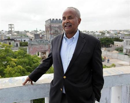 Governor of Somalia's Central Bank Omer speaks to Reuters journalist atop building housing the bank in capital Mogadishu