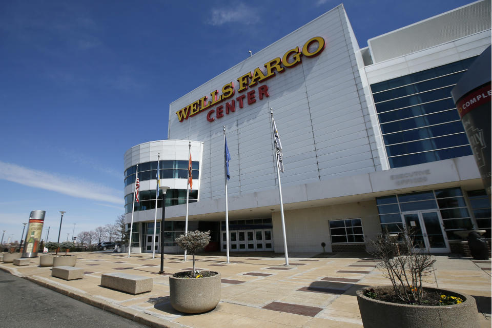The Wells Fargo Center, home of the Philadelphia Flyers NHL hockey team and the Philadelphia 76ers NBA basketball team, is seen nearly empty, Saturday, March 14, 2020, in Philadelphia. All games at the Center have been postponed due to the COVID-19 pandemic. (AP Photo/Matt Slocum)
