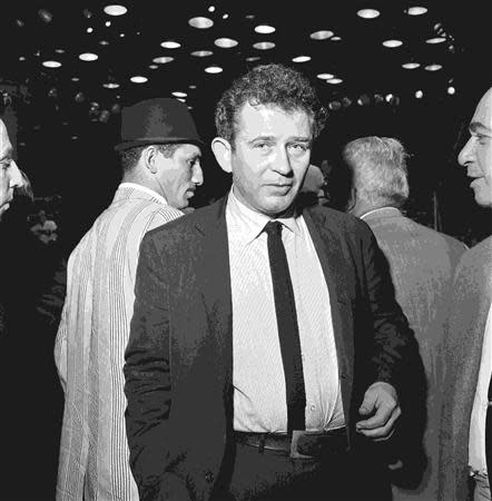 Writer Norman Mailer is seen attending the WBA/WBC World Heavyweight fight between Cassius Clay and Sonny Liston in this Miami Herald photo from HistoryMiami taken in Miami Beach, Florida February 25, 1964. REUTERS/Miami Herald/HistoryMiami/Handout