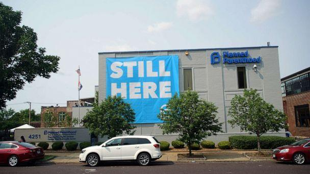 PHOTO: A banner stating 'STILL HERE' hangs on the side of the Planned Parenthood Building after a judge granted a temporary restraining order on the closing of Missouri's sole remaining Planned Parenthood clinic in St. Louis, May 31, 2019. (Lawrence Bryant/Reuters)